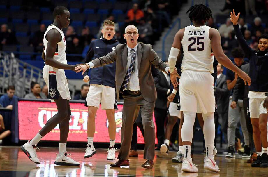 Coach Dan Hurley, center, and the UConn men's basketball team will host Iona on Wednesday. Photo: Jessica Hill / Associated Press / Copyright 2019 The Associated Press. All rights reserved