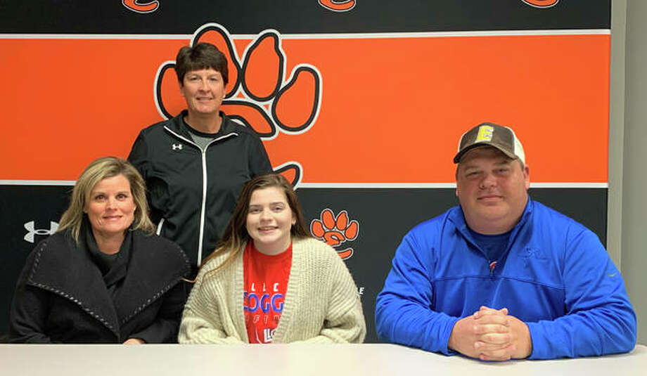 Edwardsville High School senior Sydney Webber, seated center, will play softball for Lincoln Land Community College in Springfield. She is joined by her parents and EHS coach Lori Blade. Photo: Matt Kamp|The Intelligencer