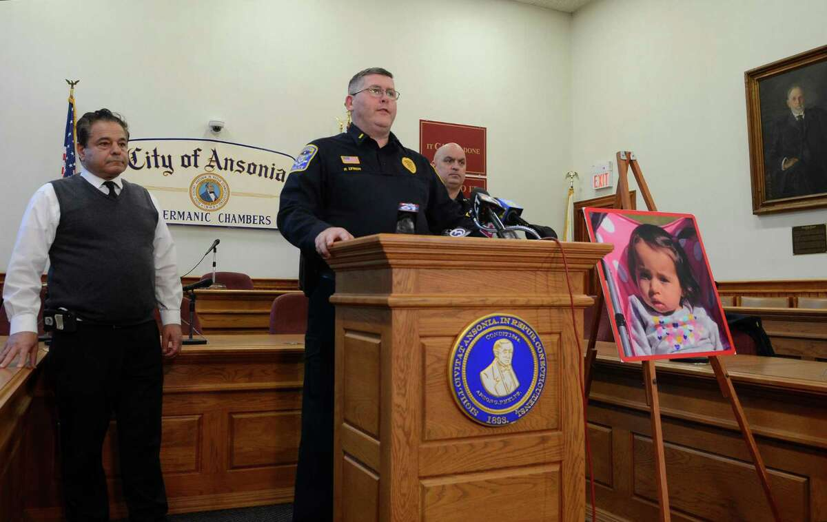 Ansonia Police Lt. Patrick Lynch speaks to the media on a homicide and missing child during a press conference held at Ansonia City Hall in Ansonia, Conn., on Tuesday Dec. 3, 2019. At left is Ansonia Mayor David S. Cassetti and at right is Chief Andrew Cota. One-year-old Vanessa Morales is missing after the body of a woman police believe is the mother was found deceased at a home on Myrtle Avenue.