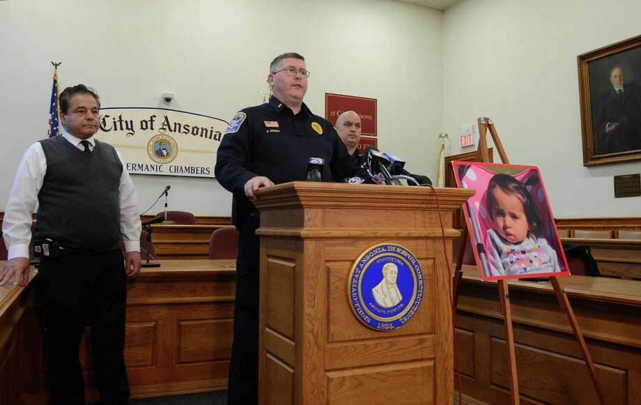 Ansonia Police Lt. Patrick Lynch speaks to the media on a homicide and missing child during a press conference held at Ansonia City Hall in Ansonia, Conn., on Tuesday Dec. 3, 2019. At left is Ansonia Mayor David S. Cassetti and at right is Chief Andrew Cota. One-year-old Vanessa Morales is missing after the body of a woman police believe is the mother was found deceased at a home on Myrtle Avenue. Photo: Christian Abraham / Hearst Connecticut Media / Connecticut Post