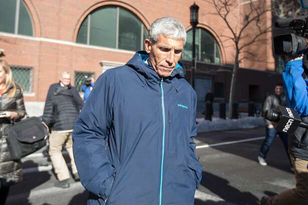 William Rick Singer leaves Boston Federal Court after being charged with racketeering conspiracy, money laundering conspiracy, conspiracy to defraud the United States, and obstruction of justice on March 12, 2019 in Boston, Ma.