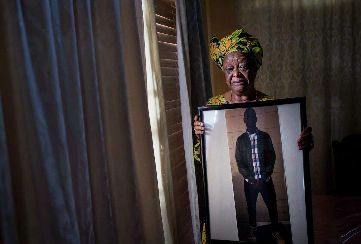 """""""When he got hurt, it changed my whole life,"""" Kadiatu Lamin said of her son, Mohamed Gordon, who fell on Monday, Oct. 21, 2019, in Missouri City. She cries while holding a photo of her son, Mohamed Gordon, in her dining room. She says he lost his sight in his right eye while in ICE custody after he wasn't given proper medical care after an altercation. """"Being blind is like taking somebody's life away,"""" she said. Her son's immigration problems began after a string of misdemeanors, which she says started when he met a new group of friends in the United States. """"You come from a good home, why do you want to mingle with these people?"""" she asked. The family fled Sierra Leone because of the war, during which she said many members of their family were killed."""