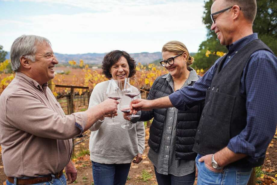 (l-r) Vineyard manager Mike Wolf toasts with winemaker Francoise Peschon and owners Heather and Bruce Phillips at Vine Hill Ranch vineyard in Oakville, California, on Tuesday, Dec. 3, 2019. Photo: Gabrielle Lurie / The Chronicle