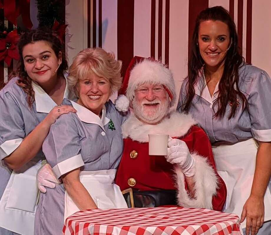 Center Stage Theatre is presenting A Center Stage Christmas. Pictured are, left to right, Sandra Fernandes, Margaret Mikan, Jim Lones, as Santa, and Shannon Lynch. Photo: Contributed Photo / Connecticut Post