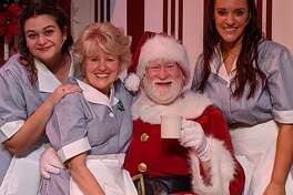 Center Stage Theatre is presenting A Center Stage Christmas. Pictured are, left to right, Sandra Fernandes, Margaret Mikan, Jim Lones, as Santa, and Shannon Lynch.