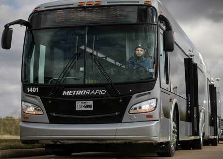 Kevin Abraham, a mechanic with Metropolitan Transit Authority, poses for a photo in one of the new 60-foot buses that will operate the Uptown bus rapid transit line, on Nov. 25, 2019, in Houston. Metro officials plan to begin testing the routes after the holidays, and service is scheduled to begin in March.