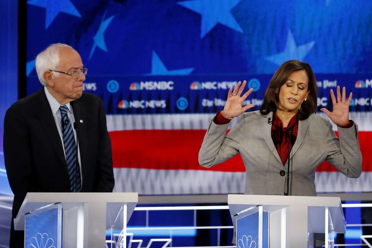 Sen. Kamala Harris, D-Calif. and Democratic presidential candidate Sen. Bernie Sanders, I-Vt.have sent a letter to major US airlines about coronavirus-related refunds. Here they appear at a Democratic presidential primary debate, Wednesday, Nov. 20, 2019, in Atlanta. (AP Photo/John Bazemore)