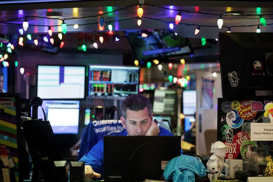 A stock trader works at the New York Stock Exchange, Tuesday, Dec. 3, 2019. Stocks fell broadly Tuesday after President Donald Trump cast doubt over the potential for a trade deal with China this year and threatened to impose tariffs on French goods. (AP Photo/Mark Lennihan) Photo: Mark Lennihan / Copyright 2019 The Associated Press. All rights reserved