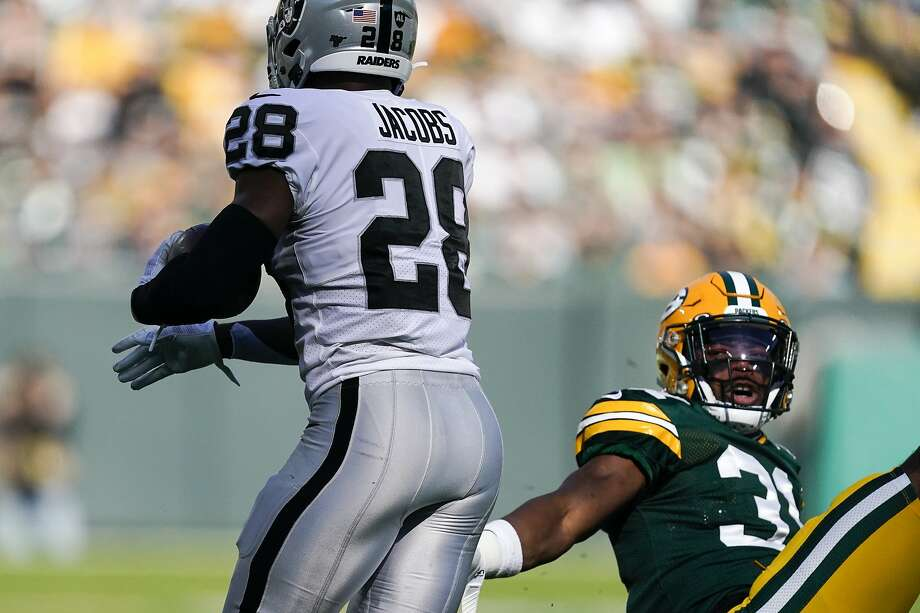 Oakland Raiders' Josh Jacobs gets past Green Bay Packers' Adrian Amos during the first half of an NFL football game Sunday, Oct. 20, 2019, in Green Bay, Wis. (AP Photo/Morry Gash) Photo: Morry Gash / AP