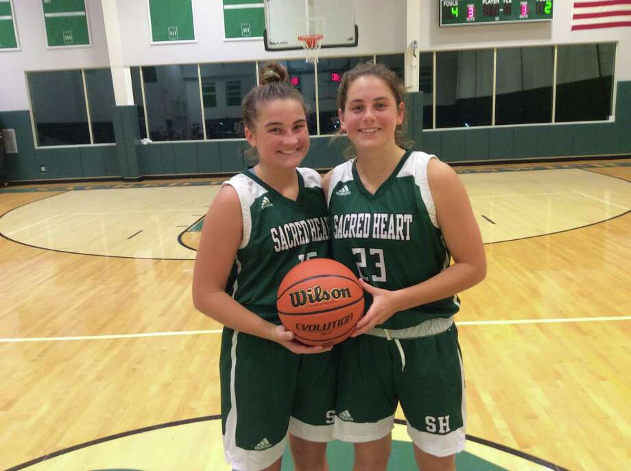 Morgan Smith, left, and Leah Atkins are senior captains of the Sacred Heart Greenwich basketball team. Photo: David Fierro /Hearst Connecticut Media