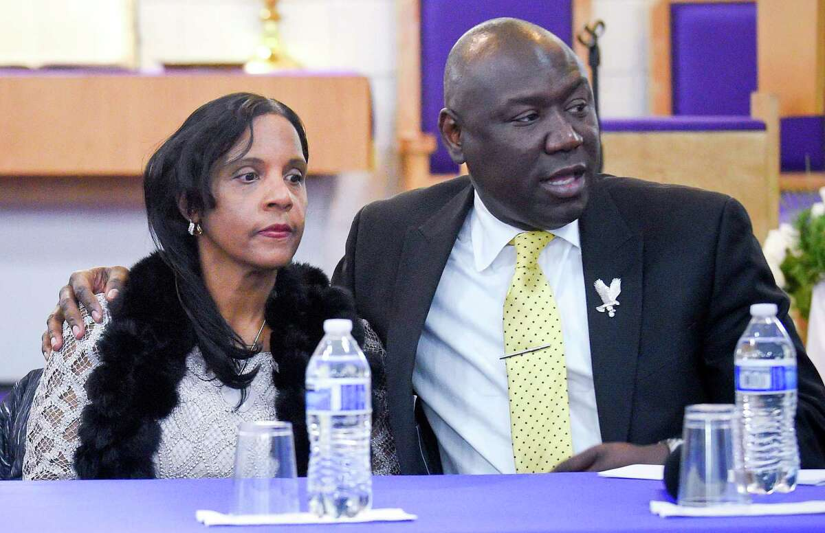Attorney Benjamin Crump, at right, holds Valerie Jaddo as introductions are made at a Community Rally for Justice at Bethel A.M.E. Church in Stamford, Conn on Dec. 3, 2019. About 100 members of the community, civic leaders and family turned out for Steven Barrier, a 23-year-old Stamford man who died in police custody in October.