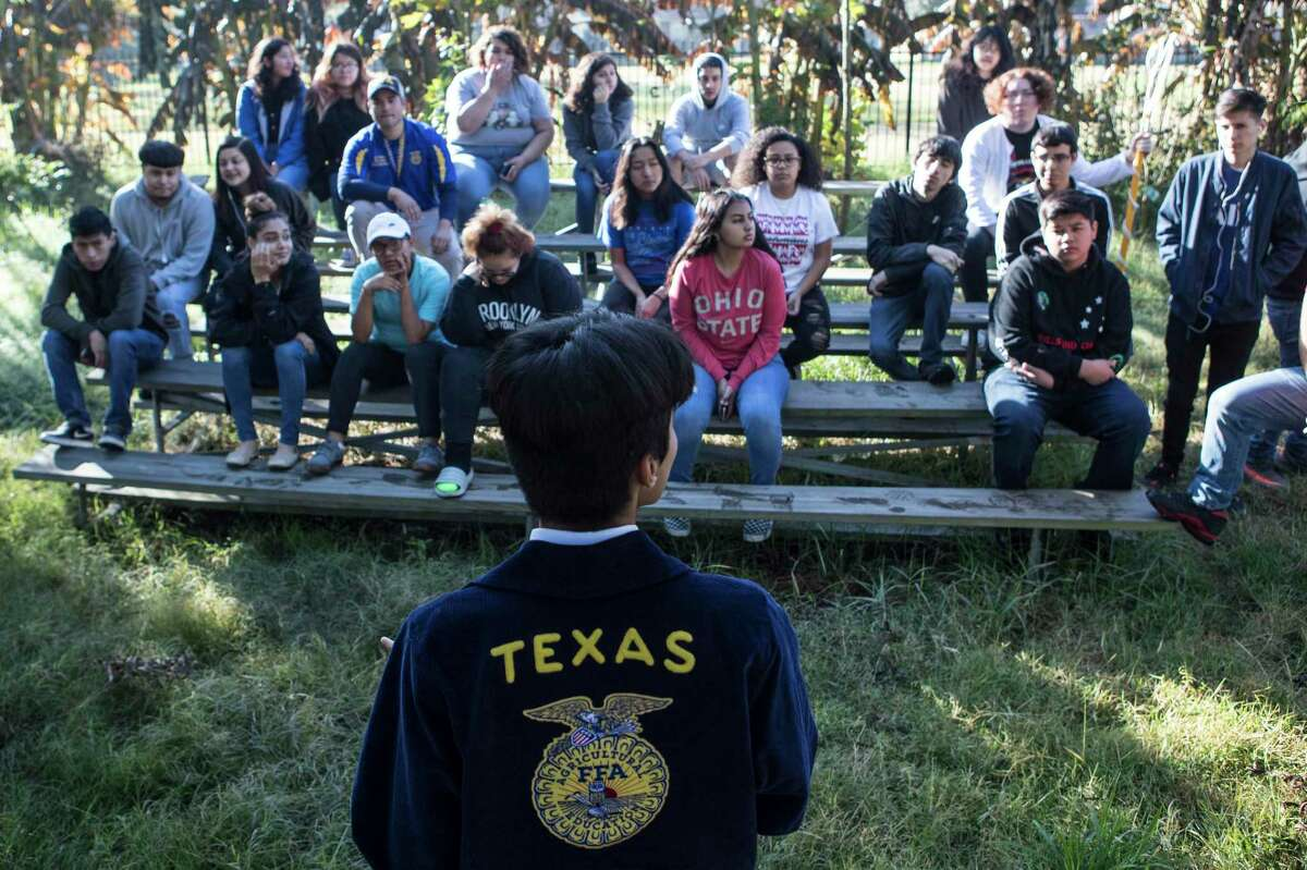 Juan Gallegos talks to Furr High School FFA group as they arrive to the community garden near the school on Tuesday, Nov. 19, 2019, in Houston. Furr, in northeast Houston, has become the first environmental justice school in the country thanks to a $10 million grant it won in 2016. The students focus on different environmental issues to become more involved in their community and collaborate with area organizations.