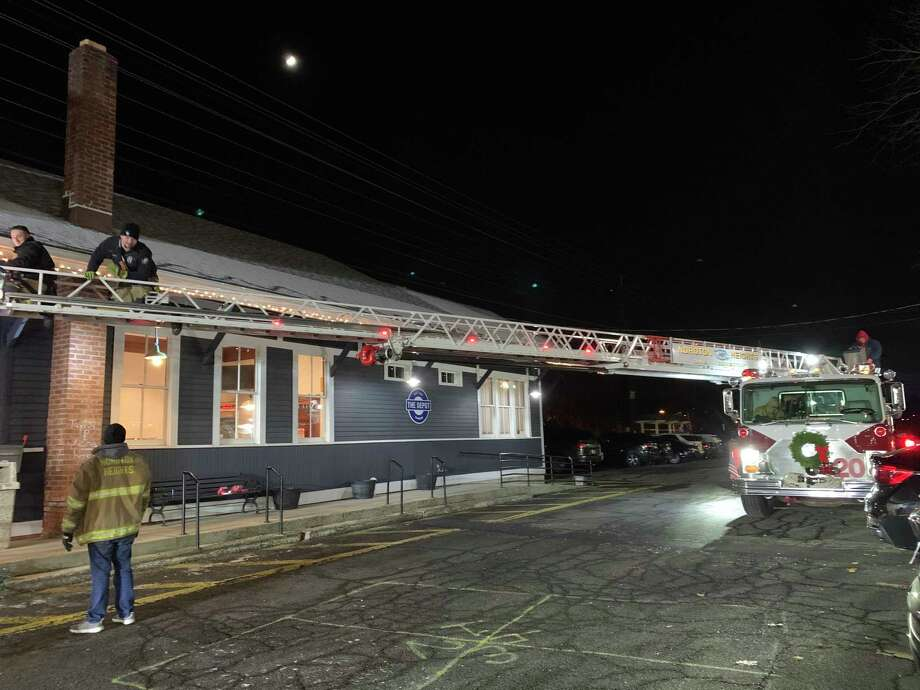 Noroton Heights Fire Department donated and installed lights at the Depot, Darien's Youth Center, Tuesday night. Photo: The Depot