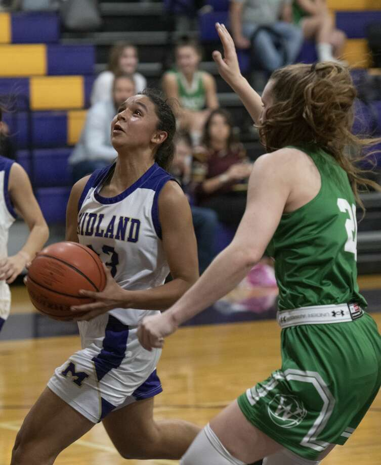 Midland High's Noemi Arciga drives the lane as Wall's Landry Reynolds tries to defend 12/03/19 at Midland High gym. Tim Fischer/Reporter-Telegram Photo: Tim Fischer/Midland Reporter-Telegram