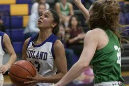 Midland High's Noemi Arciga drives the lane as Wall's Landry Reynolds tries to defend 12/03/19 at Midland High gym. Tim Fischer/Reporter-Telegram