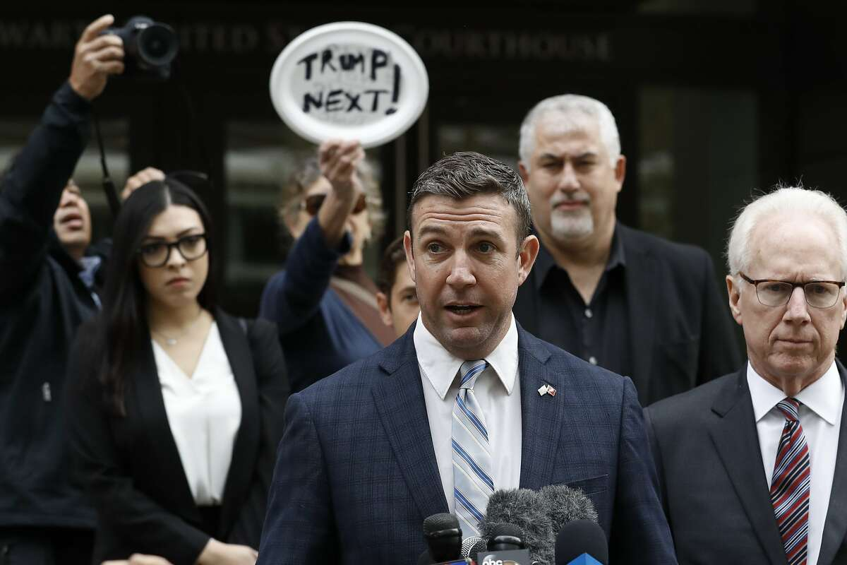 California Republican Rep. Duncan Hunter speaks after leaving federal court Tuesday, Dec. 3, 2019, in San Diego. Hunter said in a TV interview that aired Monday he plans to plead guilty to the misuse of campaign funds at a federal court hearing Tuesday in San Diego. (AP Photo/Gregory Bull)