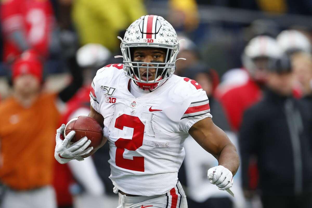 Ohio State running back J.K. Dobbins runs for a 33-yard touchdown against Michigan in the second half of an NCAA college football game in Ann Arbor, Mich., Saturday, Nov. 30, 2019. (AP Photo/Paul Sancya)