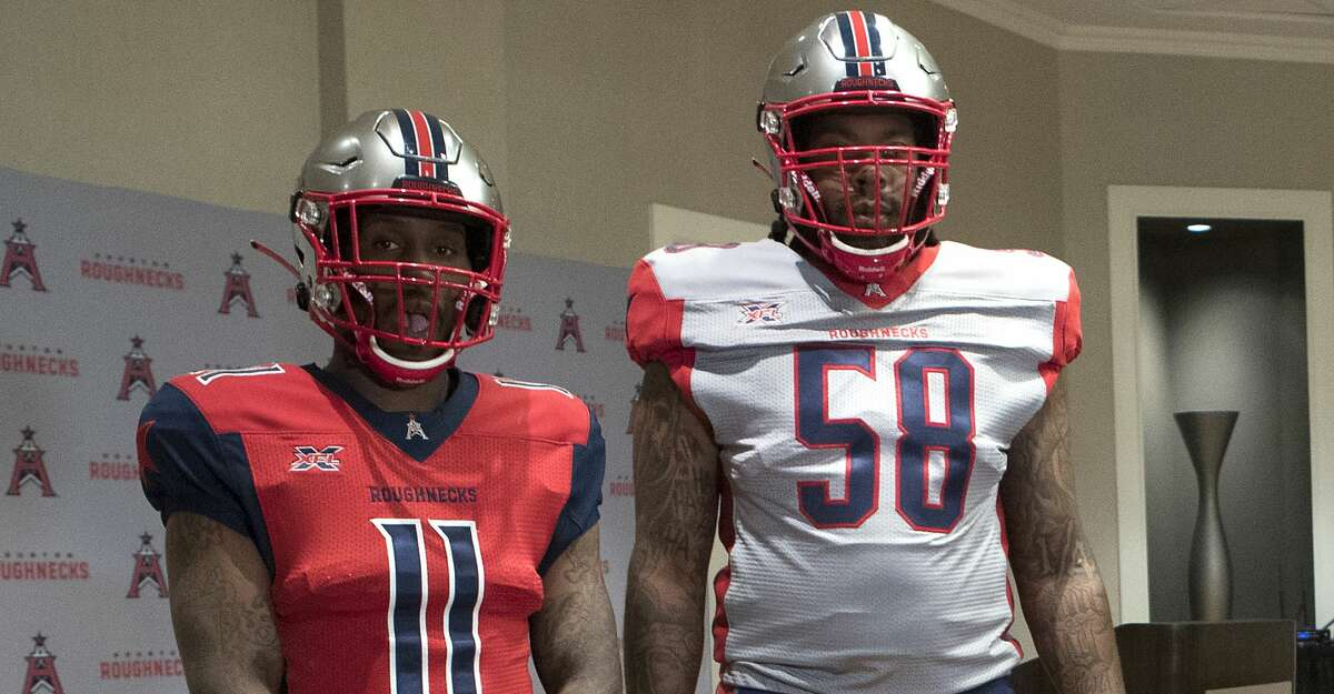 Houston Roughnecks players P.J. Walker (11) and Avery Johnson (58) show off the XFL team's uniforms during an official unveiling during a team dinner on Tuesday, Dec. 3, 2019, in Houston. The Roughnecks open Feb. 8 against the Los Angeles Wildcats at TDECU Stadium.
