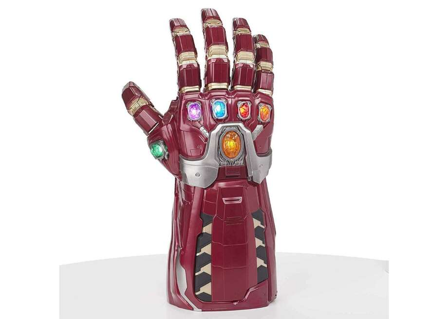 """Avengers Marvel Legends Series Endgame Power Gauntlet - Full product name: Avengers Marvel Legends Series Endgame Power Gauntlet Articulated Electronic Fist- Seller: Avengers- Amazon price: $70.54- Amazon user rating: 4.3/5 stars- Link to the toy """"Avengers: Endgame"""" was one of 2019's biggest movies, grossing almost $2.8 billion worldwide, so it's no surprise that Avengers-themed toys are a major hit this year. Advertised as a """"role play"""" item, the manufacturer recommends this power gauntlet for ages 18 and up. With its six light-up infinity stones and a range of """"Avengers"""" sound effects, the gauntlet gives its owners """"the power to control and contort the fabric of the universe."""" This slideshow was first published on theStacker.com Photo: Avengers"""