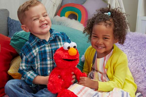 "Sesame Street Love to Hug Elmo - Full product name: Sesame Street Love to Hug Elmo Talking, Singing, Hugging 14"" Plush Toy for Toddlers, Kids 18 Months & Up - Seller: Sesame Street - Amazon price: $21.88 - Amazon user rating: 4.1/5 stars - Link to the toy While no Elmo craze has ever topped that of the 1990s Tickle Me Elmo, Love to Hug Elmo may come close. The plush doll loves to give hugs and kisses and responds with sweet words and songs after a child initiates a hug first. The toy has both an English and a Spanish mode, making the beloved ""Sesame Street"" character a great companion for kids who speak English or Spanish, or both. This slideshow was first published on theStacker.com"