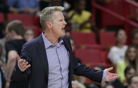 Golden State Warriors head coach Steve Kerr argues a call after losing a challenge during the second half of an NBA basketball game against the Miami Heat, Friday, Nov. 29, 2019, in Miami. (AP Photo/Lynne Sladky)