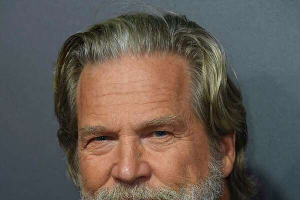 """FILE - In this Sept. 22, 2018 file photo, Jeff Bridges arrives at the Los Angeles premiere of """"Bad Times at the El Royale."""" The Hollywood Foreign Press Association announced Monday that Bridges will be honored with the Cecil B. DeMille Award at the Golden Globe Awards ceremony on Jan. 6, 2019. The actor is known for starring in films including a€œCrazy Heart,a€ a€œThe Big Lebowski,a€ a€œTrue Grita€ and a€œHell or High Water.a€ (Photo by Jordan Strauss/Invision/AP, File)"""