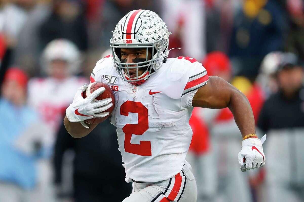 Ohio State running back J.K. Dobbins runs for a 33-yard touchdown against Michigan in the second half of an NCAA college football game in Ann Arbor, Mich., Saturday, Nov. 30, 2019.