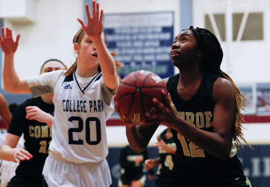 Conroe guard Tiarra Howard (12) looks to shoot as College Park shooting guard Lily Brotherton (20) closes in during the first quarter of a District 15-6A high school basketball game at College Park High School, Tuesday, Dec. 3, 2019, in The Woodlands. Photo: Gustavo Huerta, Houston Chronicle / Staff Photographer / Houston Chronicle