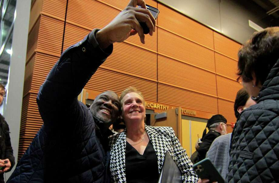 Dr. Kevin Hibbert snaps a selfie with First Selectman Vicki Tesoro after Trumbull's swearing-in ceremony on Tuesday. Photo: Christian Abraham / Hearst Connecticut Media / Connecticut Post