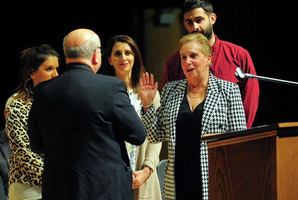 First Selectman Vicki Tesoro is sworn in by her husband Thomas at the Trumbull Swearing-In Ceremony held at Trumbull High School in Trumbull, Conn., on Tuesday Dec. 3, 2019.