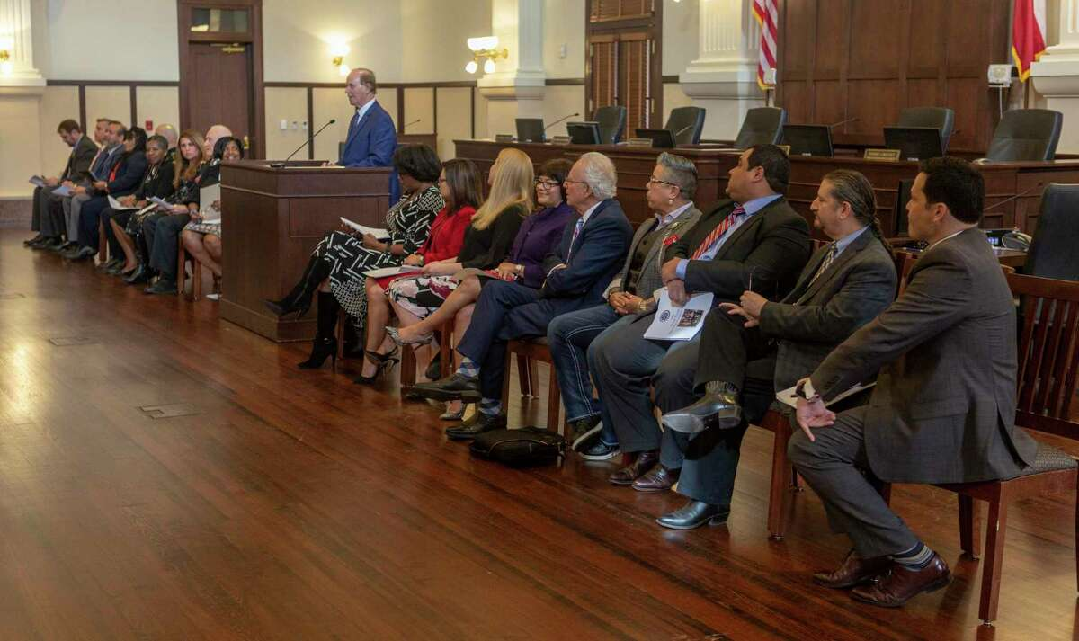 Judges from Bexar County's specialty courts and other officials listen in the Bexar County Commissioners Court as County Judge Nelson Wolff speaks on Nov. 6 during a press conference introducing the Bexar County Specialty Courts Coalition.