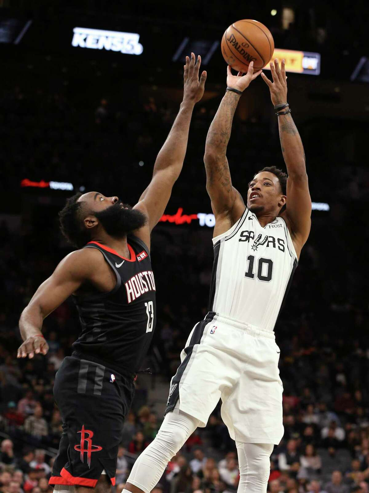 Spurs' DeMar DeRozan (10) shoots against Houston Rockets' James Harden (13) during their game at the AT&T Center on Tuesday, Dec. 3, 2019.
