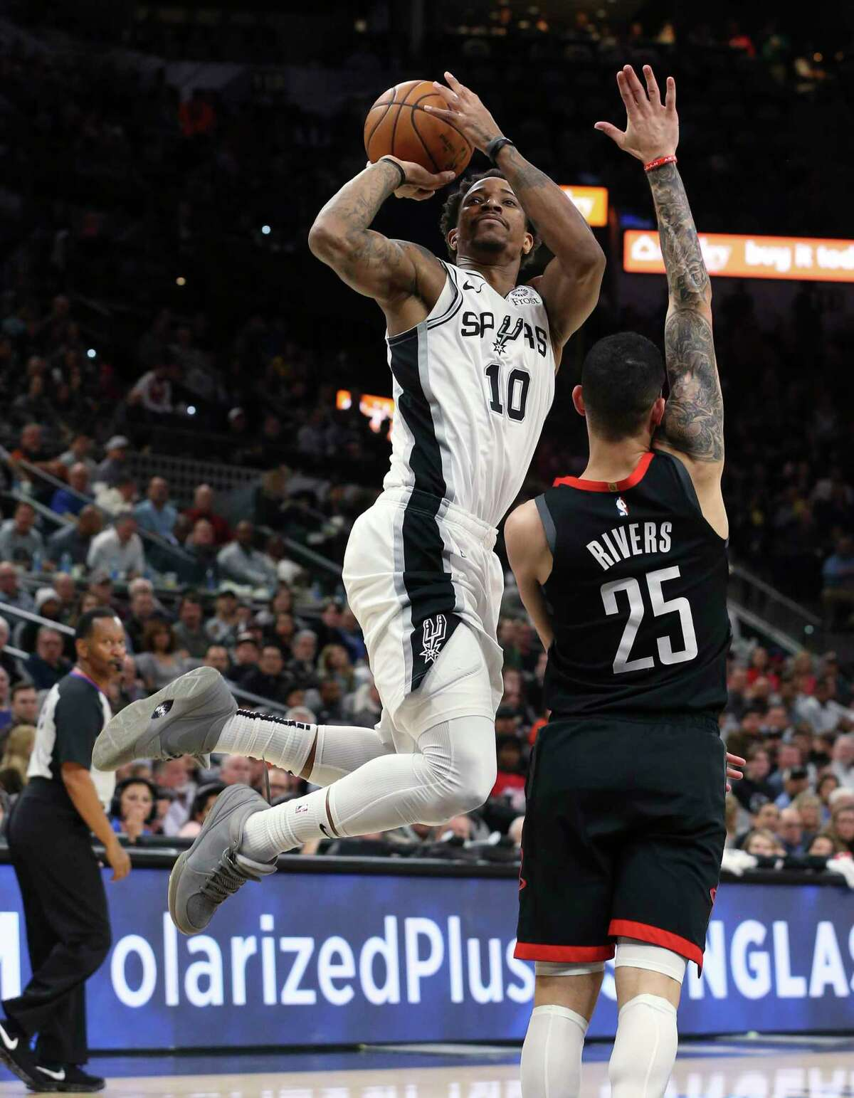 Spurs' DeMar DeRozan (10) shoots after a foul by Houston Rockets' Austin Rivers (25) during their game at the AT&T Center on Tuesday, Dec. 3, 2019.