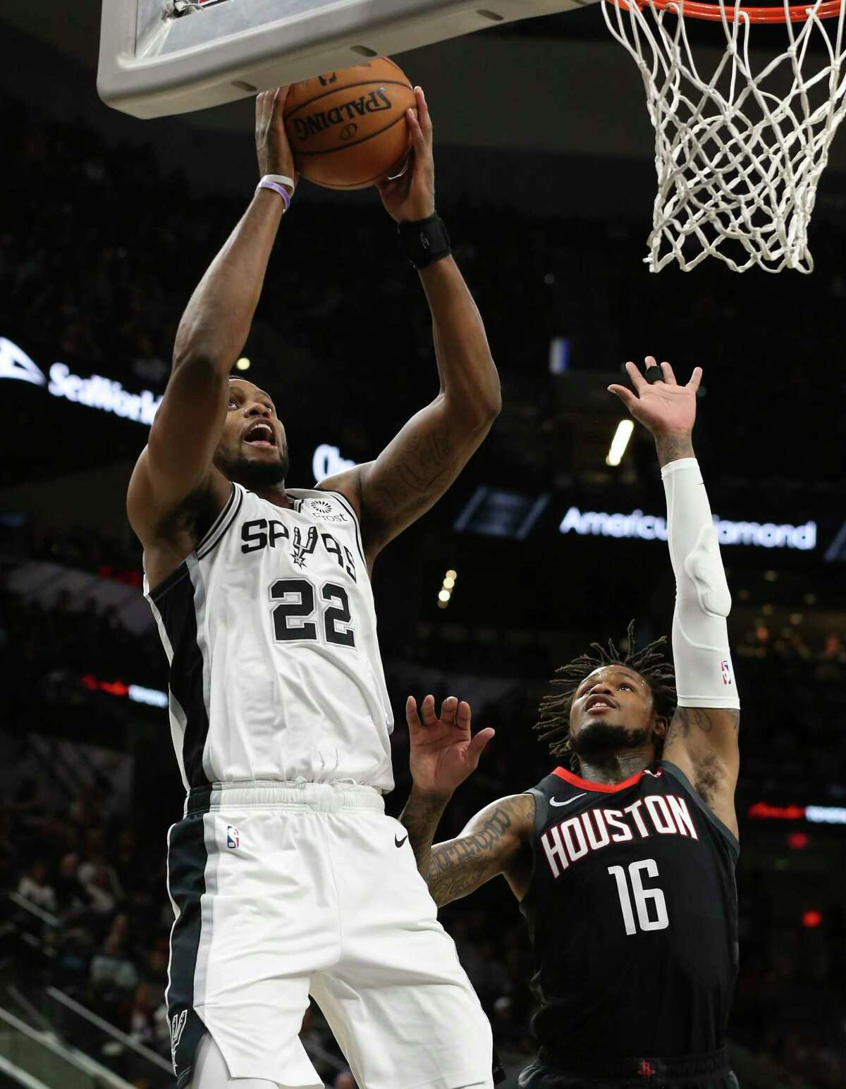 Spurs' Rudy Gay (22) scores against Houston Rockets' Ben McLemore (16) during their game at the AT&T Center on Tuesday, Dec. 3, 2019.
