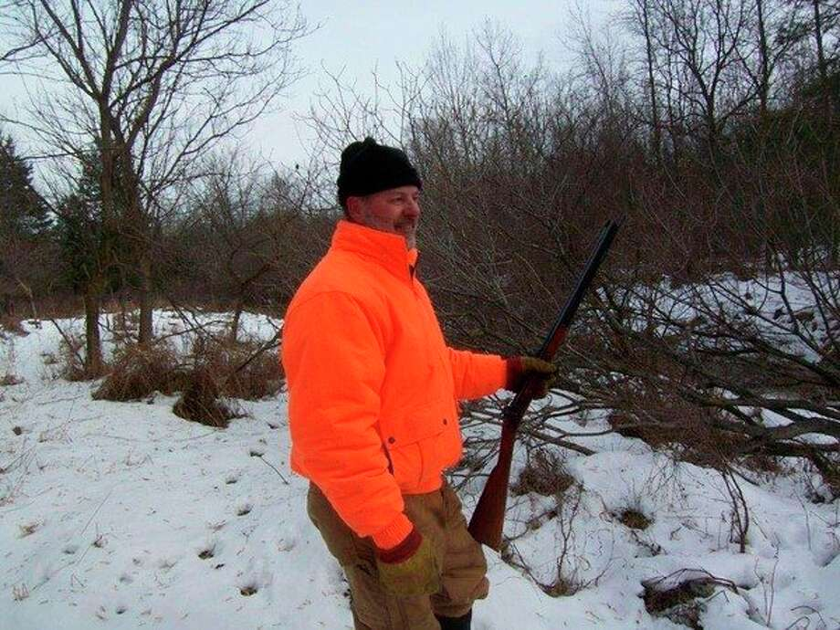 Jerry Rayl, of Decker, prefers to stick with his traditional .50 caliber T/C New Englander stoked with two roundballs for December muzzleloader deer drives. (Tom Lounsbury/Hearst Michigan)