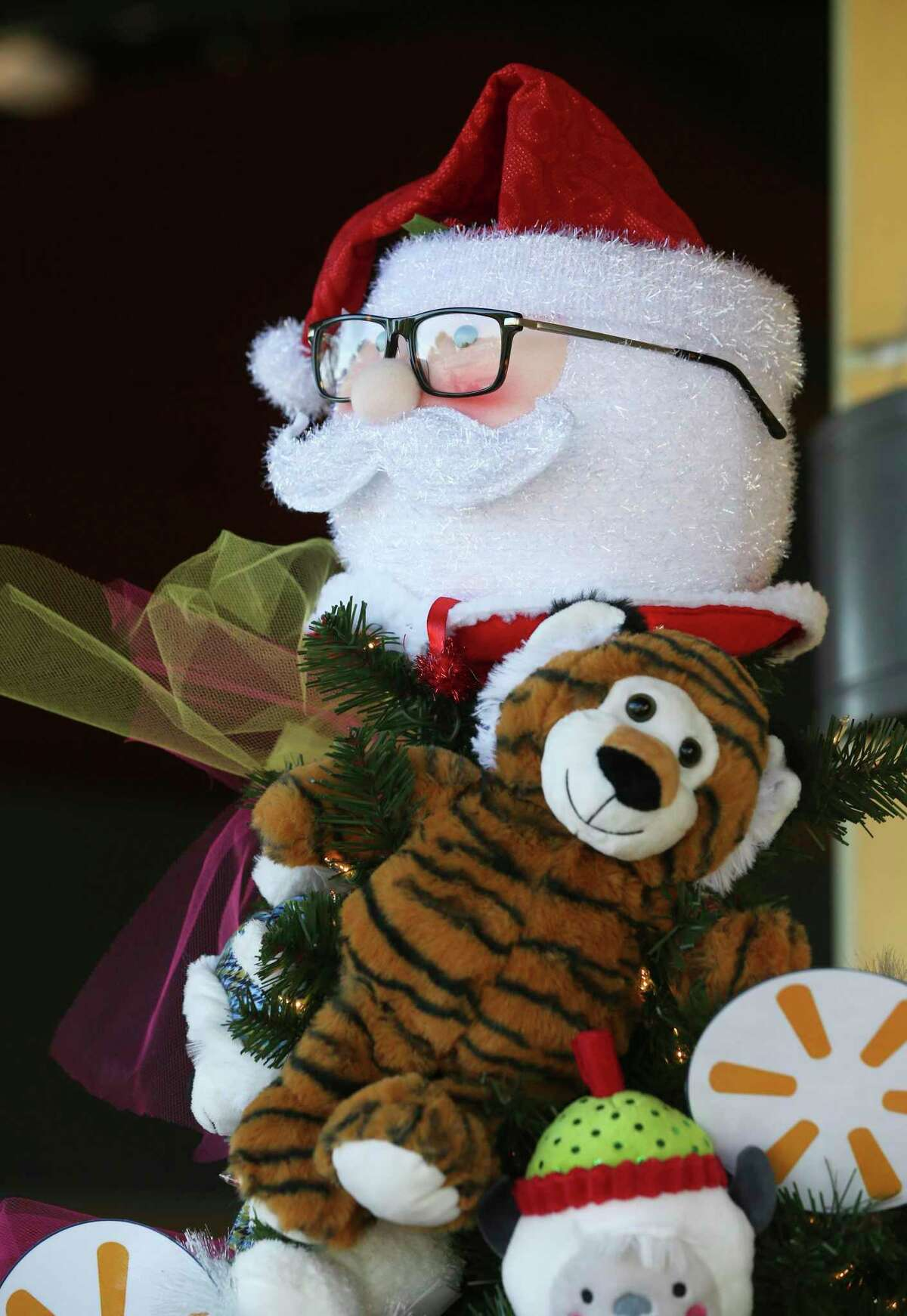 A Santa face tops the tree as local businesses decorate Christmas trees at the Children's Shelter campus on Dec. 3, 2019.