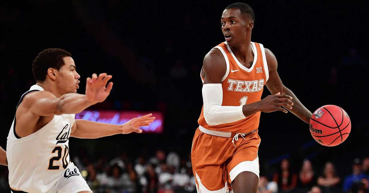 Andrew Jones (1) of the Texas Longhorns drives past Matt Bradley of the California Golden Bears during the first half of a game at Madison Square Garden on Nov. 22, 2019 in New York City.