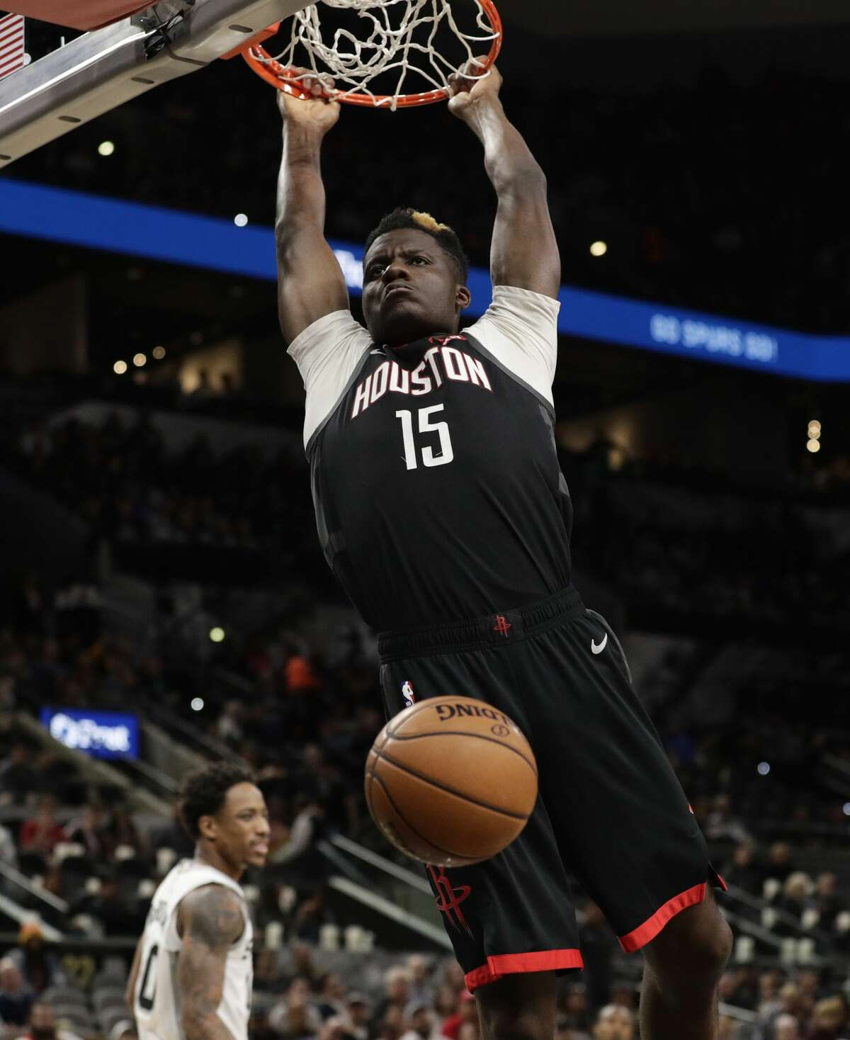 Houston Rockets center Clint Capela scores against the San Antonio Spurs during the first half of an NBA basketball game in San Antonio, Tuesday, Dec. 3, 2019. (AP Photo/Eric Gay)