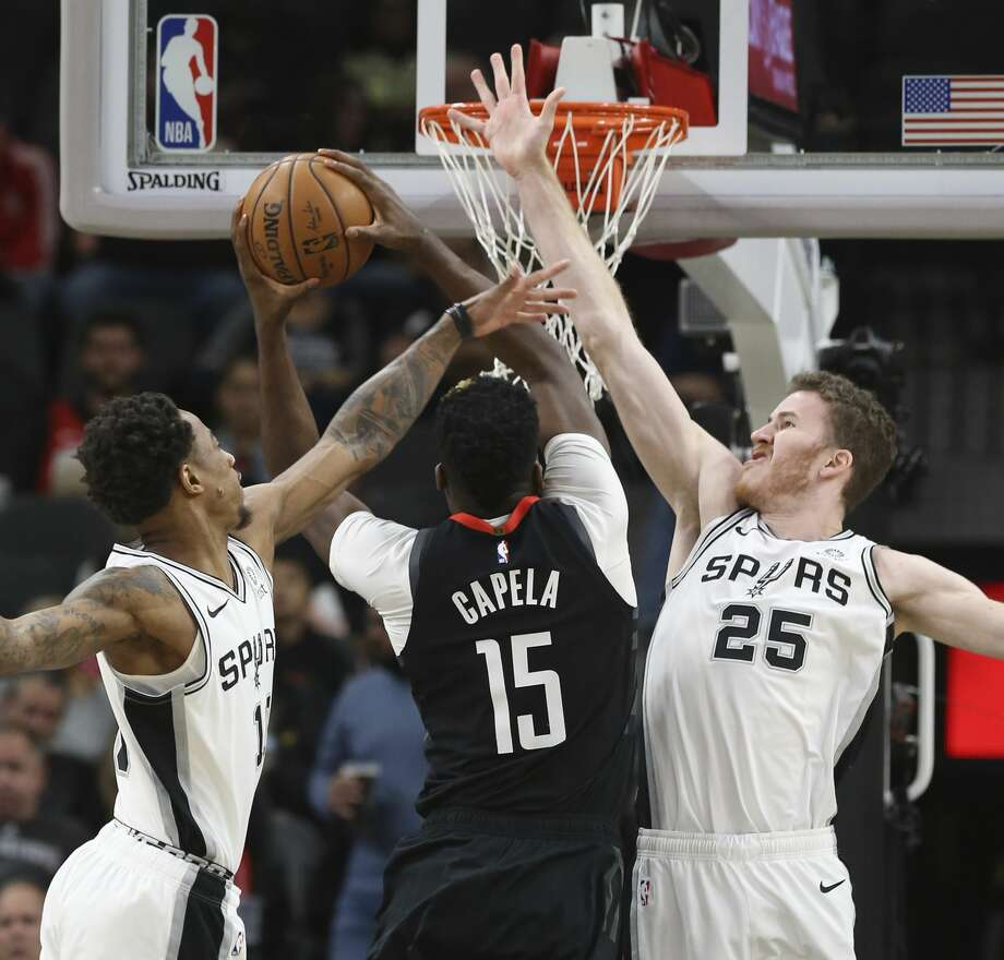 Spurs' DeMar DeRozan (10) and Jakob Poeltl (25) defend against Houston Rockets' Clint Capela (15) during their game at the AT&T Center on Tuesday, Dec. 3, 2019. Photo: Kin Man Hui/Staff Photographer