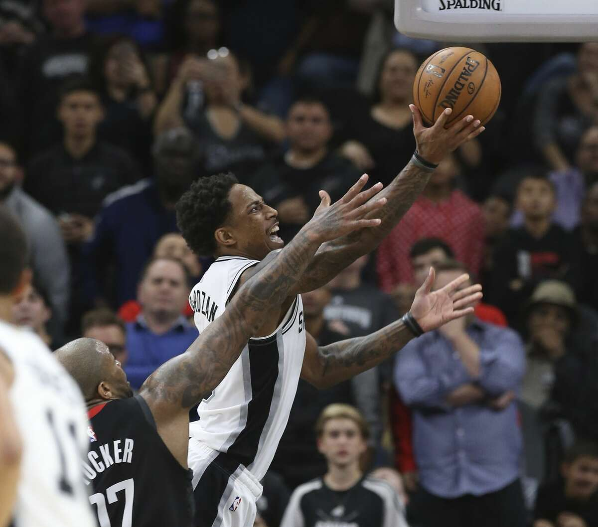 Spurs' DeMar DeRozan (10) goes strong to the basket against Houston Rockets' PJ Tucker (17) during their game at the AT&T Center on Tuesday, Dec. 3, 2019. Spurs rally from 22 points to defeat the Rockets, 135-133, in double overtime.