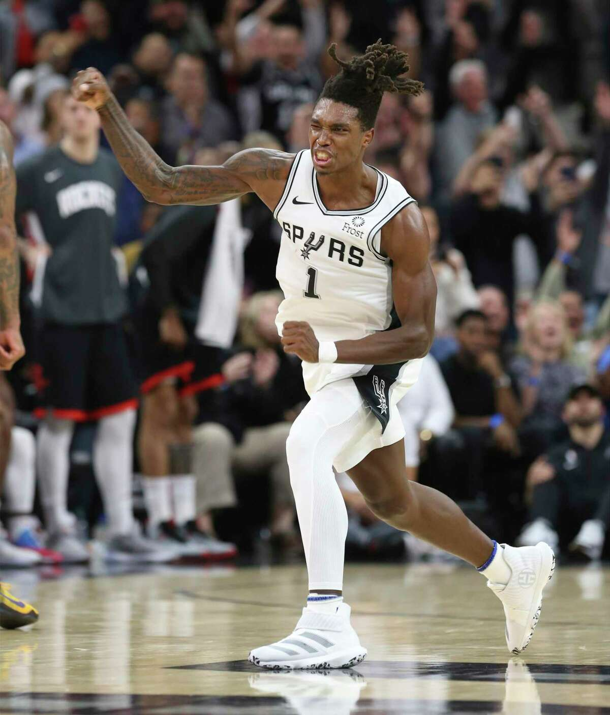 Spurs' Lonnie Walker IV (01) reacts after hitting a three against the Houston Rockets during their game at the AT&T Center on Tuesday, Dec. 3, 2019. Spurs rally from 22 points to defeat the Rockets, 135-133, in double overtime.