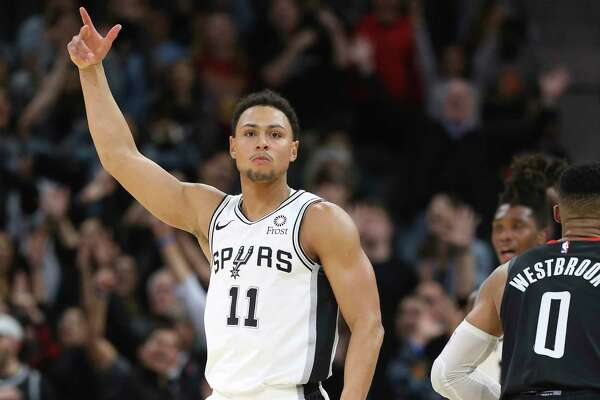 Spurs' Bryn Forbes (11) reacts after hitting a three pointer against the Houston Rockets in overtime during their game at the AT&T Center on Tuesday, Dec. 3, 2019. Spurs rally from 22 points to defeat the Rockets, 135-133, in double overtime.