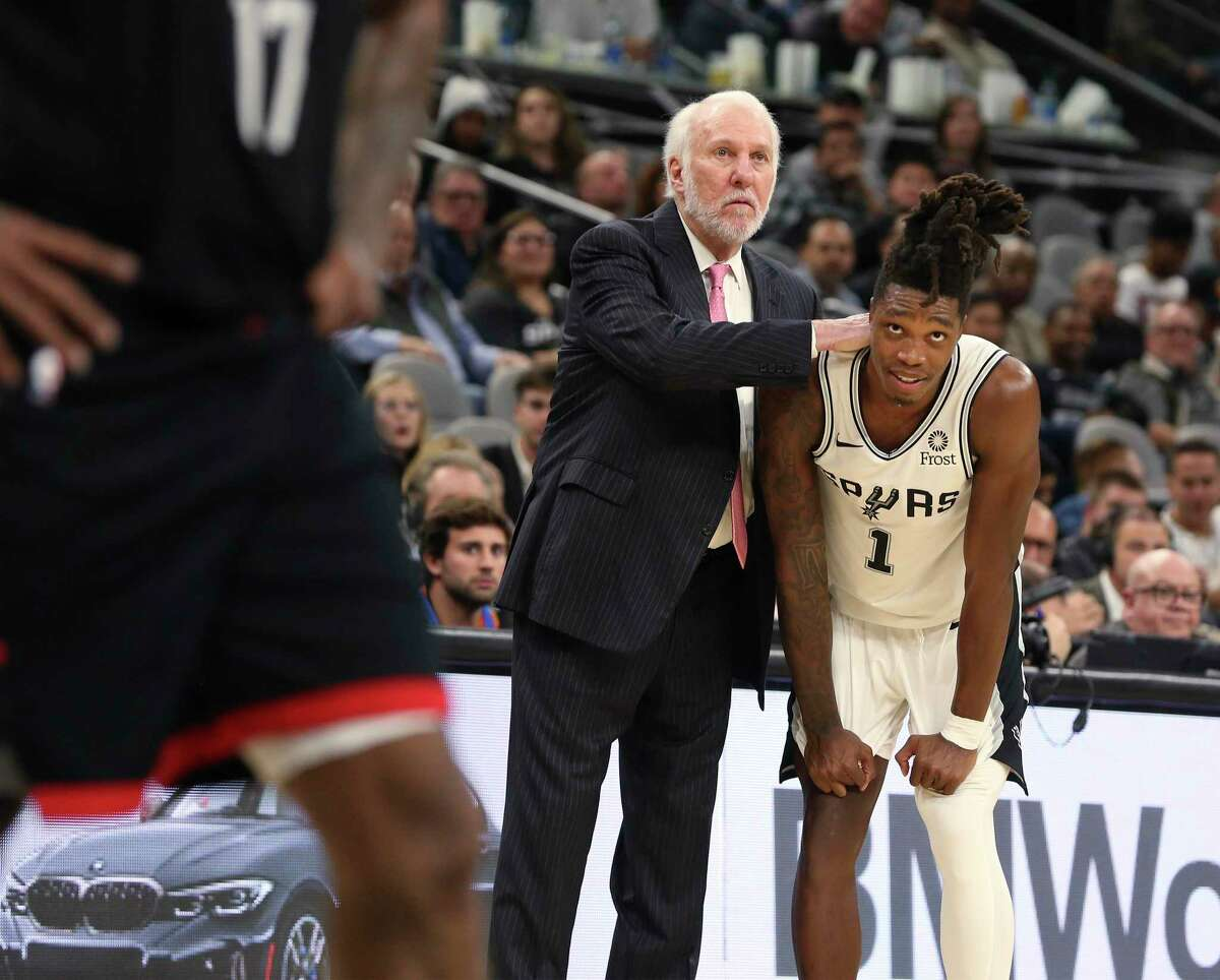 Gregg Popovich encourages Lonnie Walker IV during Tuesday's 135-133 double-overtime win over Houston. Walker saved the Spurs with 19 fourth-quarter points, including a 3-pointer from way downtown that forced the first overtime.