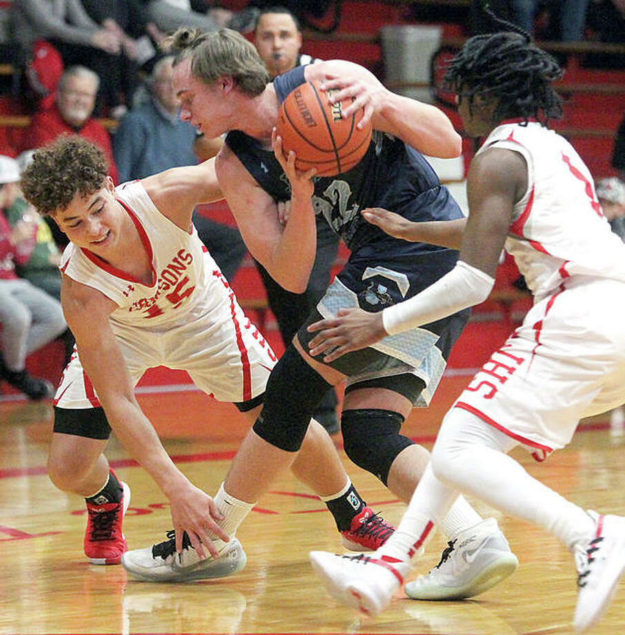 Jersey's Tucker Shalley keeps control of the ball under pressure during a game at Jacksonville Monday night. The Panthers rallied to win the game 51-48. Photo: Dennis Mathes, Journal-Courier | For The Telegraph