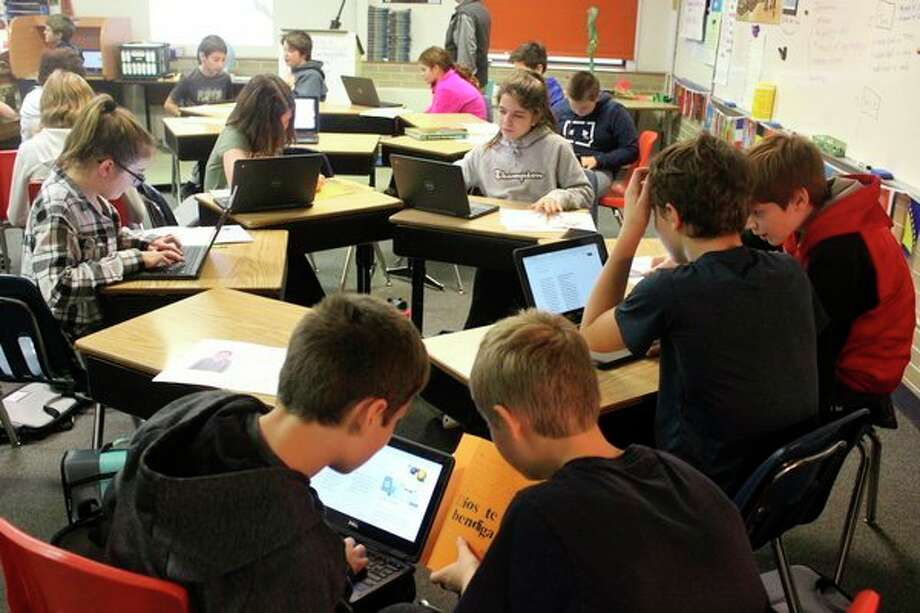 Students eagerly translate their letters from Elohim School. (Photo/Robert Myers)