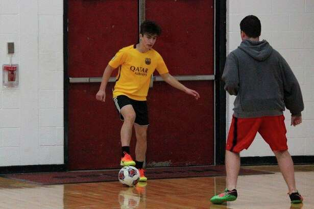 All-state sophomore Kevin Hubbell works against former all-state alumnus Nick Baesch in pick-up soccer. (Photo/Robert Myers)