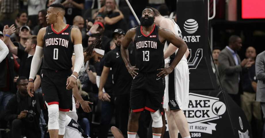 Houston Rockets guard Russell Westbrook (0) and guard James Harden (13) react to a play during overtime of an NBA basketball game against the San Antonio Spurs, in San Antonio, Tuesday, Dec. 3, 2019. San Antonio won 135-133 in double overtime. (AP Photo/Eric Gay) Photo: Eric Gay/Associated Press