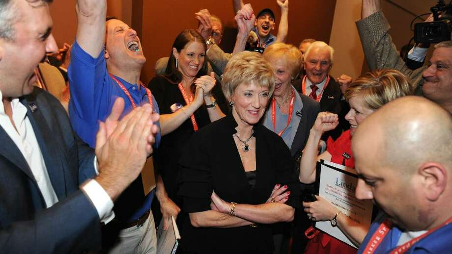 Linda McMahon clinches the nomination for US Senate during the GOP convention in downtown Hartford, Conn. on Friday May 21, 2010. Here, she stands, center, with her campaign manager David Cappiello reacting at left with arm raised, and her son Shane, far left, after learning that she has won the nomination. Photo: Christian Abraham / Connecticut Post
