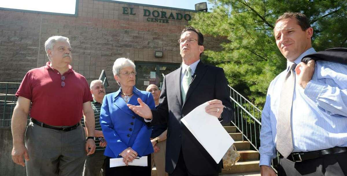 Democratic gubernatorial candidate Dan Malloy, second from right, and his running mate, Nancy Wyman, visited the CTWorks Center in Danbury Tuesday to share their plans for growing jobs in Connecticut and revitalizing the state's economy. Left is state Rep. Bob Godfrey. Right is state Rep. Joe Taborsak. Photo taken Tuesday, June 15, 2010.