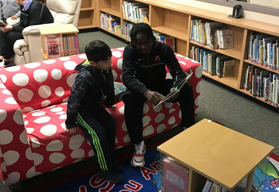 Porter basketball players read to students at Crippen Elementary School this week. Photo: Tobin Reid